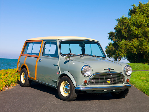 AUT 22 RK2377 01 © Kimball Stock 1965 Morris Mini Minor Traveller Woody Gray 3/4 Front View On Pavement By Water