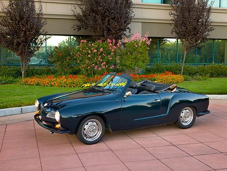 AUT 22 RK2382 01 © Kimball Stock 1969 VW Karmann Ghia Convertible Green 3/4 Side View On Pavement By Trees