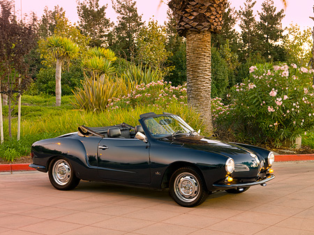 AUT 22 RK2384 01 © Kimball Stock 1969 VW Karmann Ghia Convertible Green 3/4 Side View On Pavement By Trees