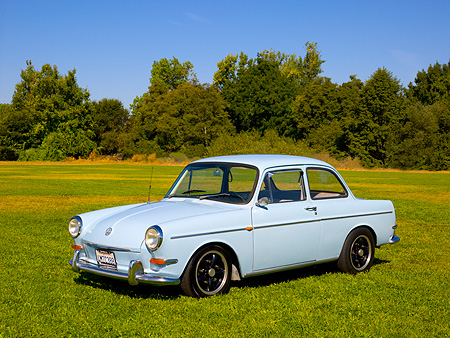 AUT 22 RK2392 01 © Kimball Stock 1965 Volkswagen Type 3 Notchback Bahama Blue 3/4 Side View On Grass Trees Background