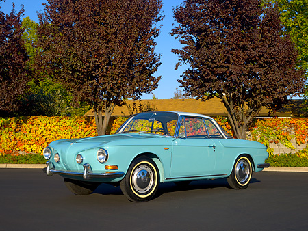 AUT 22 RK2394 01 © Kimball Stock 1964 Volkswagen Karmann Ghia Type 3 Pacific Blue 3/4 Side View On Pavement Trees Background
