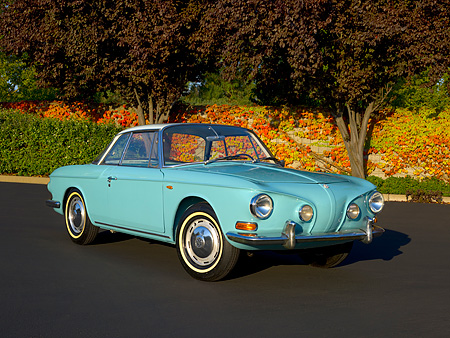 AUT 22 RK2395 01 © Kimball Stock 1964 Volkswagen Karmann Ghia Type 3 Pacific Blue 3/4 Front View On Pavement Trees Background