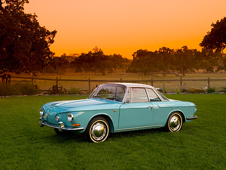 AUT 22 RK2397 01 © Kimball Stock 1964 Volkswagen Karmann Ghia Type 3 Pacific Blue  Side 3/4 View On Grass