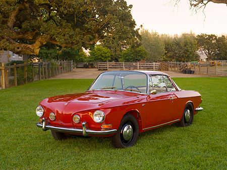 AUT 22 RK2400 01 © Kimball Stock 1963 Volkswagen Karmann Ghia Type 3 Ruby Red 3/4 Front View On Grass