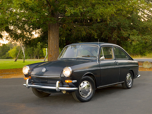 AUT 22 RK2407 01 © Kimball Stock 1967 Volkswagen Fastback Black 3/4 Front View On Pavement By Trees