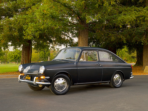 AUT 22 RK2408 01 © Kimball Stock 1967 Volkswagen Fastback Black 3/4 Side View On Pavement By Trees