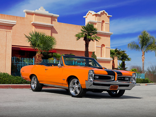 AUT 22 RK2432 01 © Kimball Stock 1966 Pontiac GTO Convertible Orange Black Stripes Low 3/4 Front View On Pavement