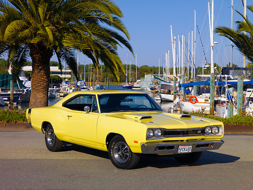 AUT 22 RK2510 01 © Kimball Stock 1969 Dodge Super Bee Yellow 3/4 Front View On Pavement By Harbor