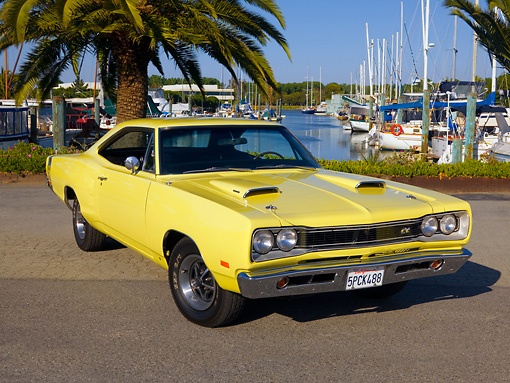 AUT 22 RK2511 01 © Kimball Stock 1969 Dodge Super Bee Yellow 3/4 Front View On Pavement By Harbor