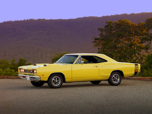 AUT 22 RK2520 01 © Kimball Stock 1969 Dodge Super Bee Yellow 3/4 Side View On Pavement