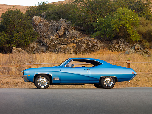AUT 22 RK2529 01 © Kimball Stock 1968 Buick GS 400 Blue Low Profile View On Pavement