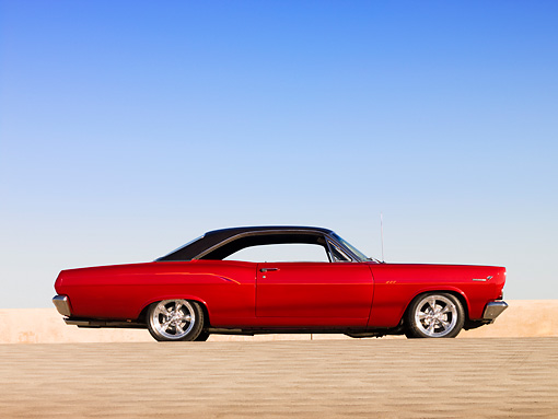 AUT 22 RK2576 01 © Kimball Stock 1966 Mercury Comet Cyclone GT Red Black Top Low Profile View On Pavement