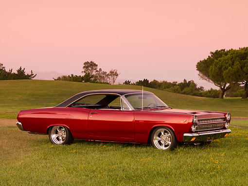 AUT 22 RK2579 01 © Kimball Stock 1966 Mercury Comet Cyclone GT Red Black Top 3/4 Side View On Grass