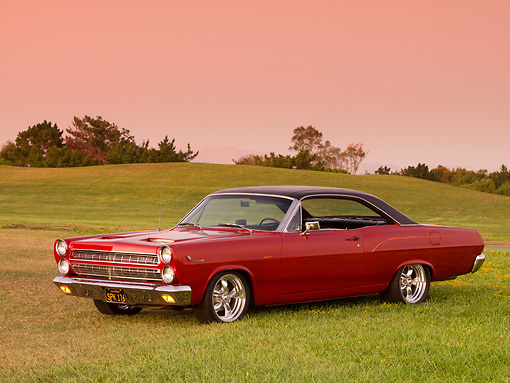 AUT 22 RK2581 01 © Kimball Stock 1966 Mercury Comet Cyclone GT Red Black Top 3/4 Side View On Grass