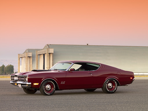AUT 22 RK2595 01 © Kimball Stock 1969 Mercury Cyclone Cobra Jet 428 Maroon 3/4 Side View On Pavement By Hangars