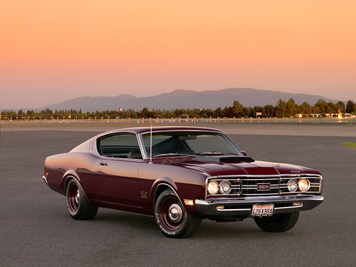 AUT 22 RK2602 01 © Kimball Stock 1969 Mercury Cyclone Cobra Jet 428 Maroon 3/4 Front View On Pavement