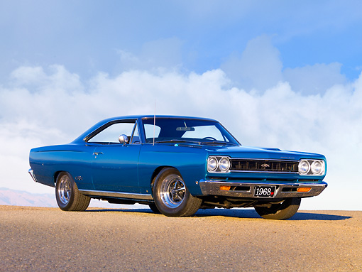 AUT 22 RK2605 01 © Kimball Stock 1968 Plymouth GTX Blue Low 3/4 Front View On Pavement Clouds Sky