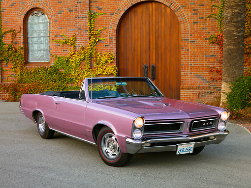 AUT 22 RK2616 01 © Kimball Stock 1965 Pontiac GTO Convertible Lavender Front 3/4 View On Pavement By Building Trees