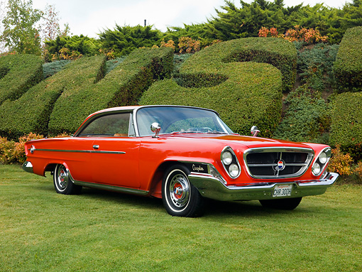 AUT 22 RK2618 01 © Kimball Stock 1962 Chrysler 300H Red Front 3/4 View On Grass By Shrubs Sky