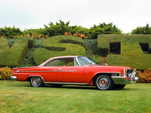 AUT 22 RK2619 01 © Kimball Stock 1962 Chrysler 300H Red Front 3/4 View On Grass By Shrubs Sky