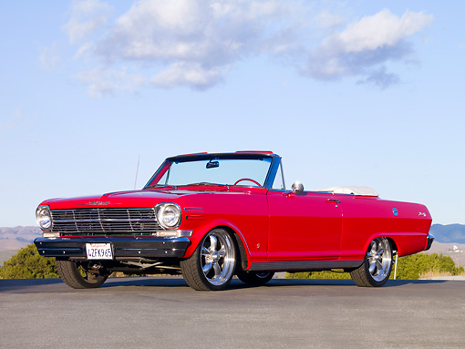 AUT 22 RK2631 01 © Kimball Stock 1962 Chevrolet Nova Convertible Red 3/4 Front View Blue Sky