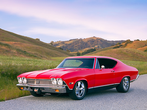 AUT 22 RK2657 01 © Kimball Stock 1968 Chevrolet Chevelle SS 396 Red And Black 3/4 Front View On Road By Grass Hills