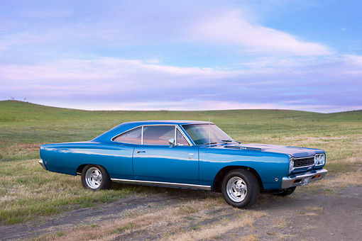 AUT 22 RK2661 01 © Kimball Stock 1969 Dodge Coronet Blue 3/4 Front View In Field By Trees
