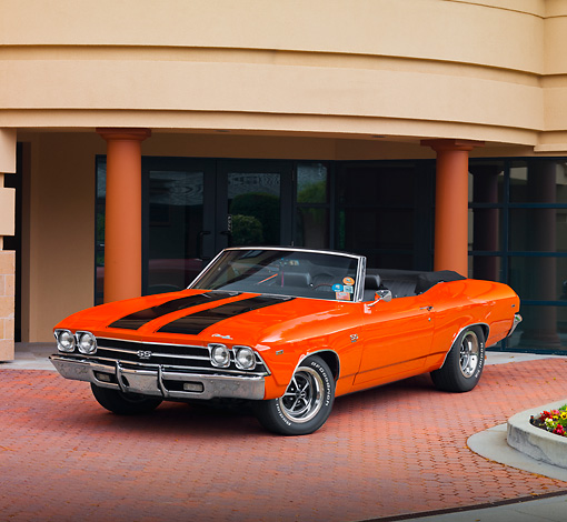 AUT 22 RK2668 01 © Kimball Stock 1969 Chevrolet Chevelle Convertible Hugger Orange 3/4 Front View By Building