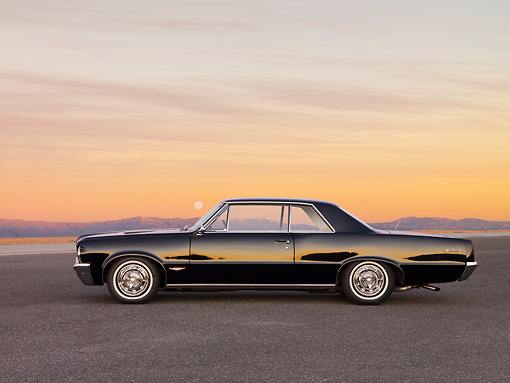 AUT 22 RK2685 01 © Kimball Stock 1964 Pontiac GTO Black Profile View At Dusk