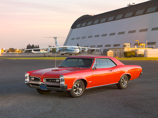 AUT 22 RK2688 01 © Kimball Stock 1966 Pontiac GTO Red 3/4 Front View By Hangar