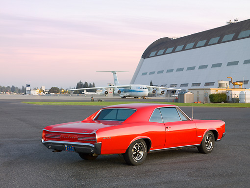 AUT 22 RK2689 01 © Kimball Stock 1966 Pontiac GTO Red 3/4 Rear View By Hangar