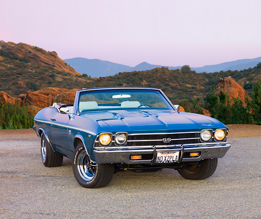 AUT 22 RK2696 01 © Kimball Stock 1969 Chevrolet Chevelle SS Convertible Blue 3/4 Front View On Pavement By Valley
