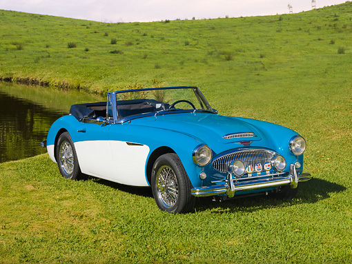 AUT 22 RK2709 01 © Kimball Stock 1963 Austin-Healey BJ7 3000 Convertbile Blue And White 3/4 Front View On Grass By Pond