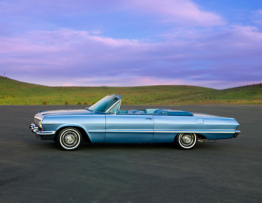 AUT 22 RK2725 01 © Kimball Stock 1963 Chevrolet Impala Convertible Blue Profile View On Pavement