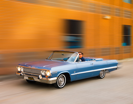 AUT 22 RK2727 01 © Kimball Stock 1963 Chevrolet Impala Convertible Blue 3/4 Front View On Pavement By Building