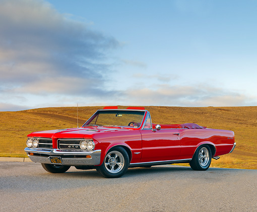 AUT 22 RK2751 01 © Kimball Stock 1964 Pontiac GTO Convertible Red 3/4 Front View On Pavement By Hills