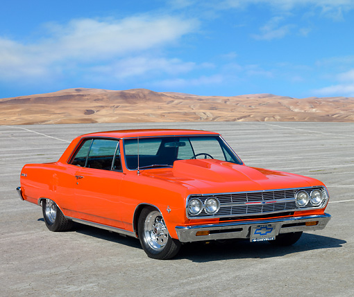 AUT 22 RK2786 01 © Kimball Stock 1965 Chevrolet Chevelle SS Hugger Orange 3/4 Front View On Pavement