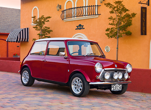 AUT 23 BK0049 01 © Kimball Stock 1975 Morris Mini 1000 Red 3/4 Front View On Brick Road By Winery