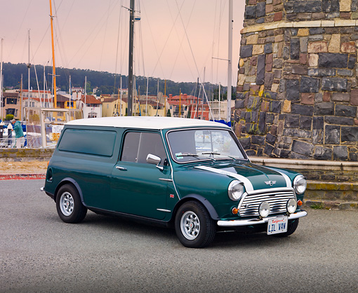 AUT 23 BK0058 01 © Kimball Stock 1978 Austin Mini Van Green 3/4 Front View On Pavement By Harbor
