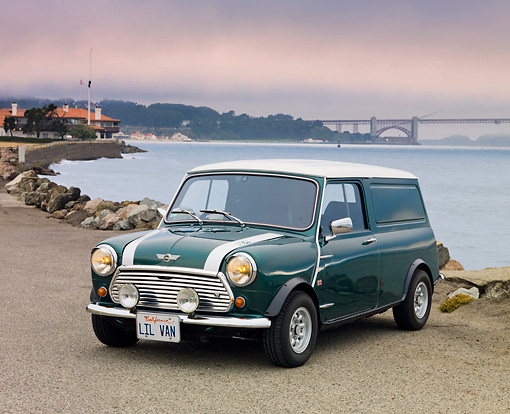 AUT 23 BK0059 01 © Kimball Stock 1978 Austin Mini Van Green 3/4 Front View On Pavement By Bay