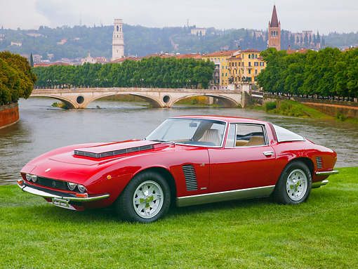 AUT 23 BK0068 01 © Kimball Stock 1970 Iso Grifo Coupe Red 3/4 Front View On Grass By Water And Bridge