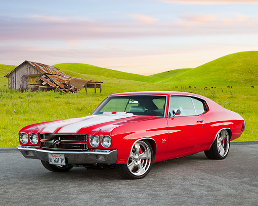 AUT 23 BK0069 01 © Kimball Stock 1970 Chevrolet Chevelle SS 454 Red With White Stripe 3/4 Front View On Pavement By Grassy Hills And Old Shed