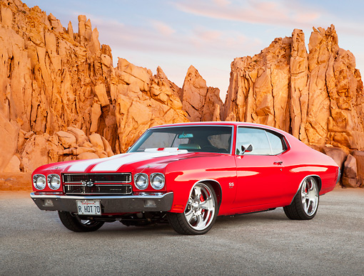 AUT 23 BK0070 01 © Kimball Stock 1970 Chevrolet Chevelle SS 454 Red With White Stripe 3/4 Front View On Pavement By Red Rock