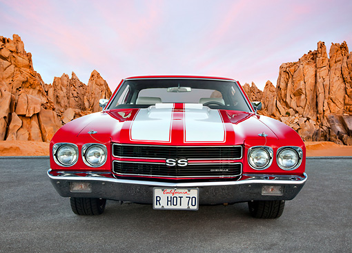 AUT 23 BK0071 01 © Kimball Stock 1970 Chevrolet Chevelle SS 454 Red With White Stripe Front View On Pavement By Red Rock
