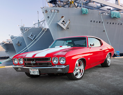 AUT 23 BK0073 01 © Kimball Stock 1970 Chevrolet Chevelle SS 454 Red With White Stripe 3/4 Front View On Pavement By Shipyard