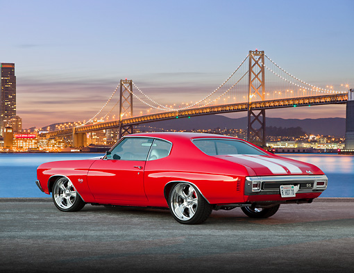 AUT 23 BK0074 01 © Kimball Stock 1970 Chevrolet Chevelle SS 454 Red With White Stripe 3/4 Rear View On Pavement By Bay Bridge At Night