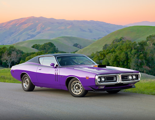 AUT 23 BK0079 01 © Kimball Stock 1971 Dodge Charger 440 Magnum R/T Purple 3/4 Front View On Pavement By Grassy Hills