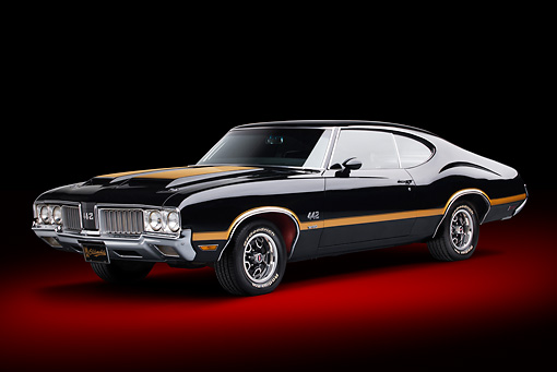 AUT 23 BK0094 01 © Kimball Stock 1970 Oldsmobile 442 W-30 Black With Gold Stripe 3/4 Front View In Studio