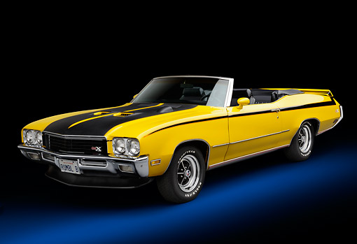 AUT 23 BK0108 01 © Kimball Stock 1971 Buick GSX Yellow With Black Stripes 3/4 Front View In Studio