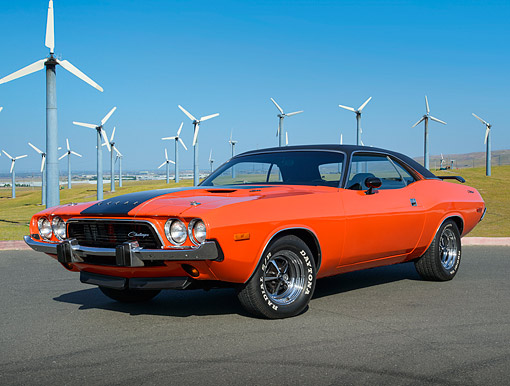 AUT 23 BK0113 01 © Kimball Stock 1973 Dodge Challenger Hemi Orange 3/4 Front View On Pavement By Windmills